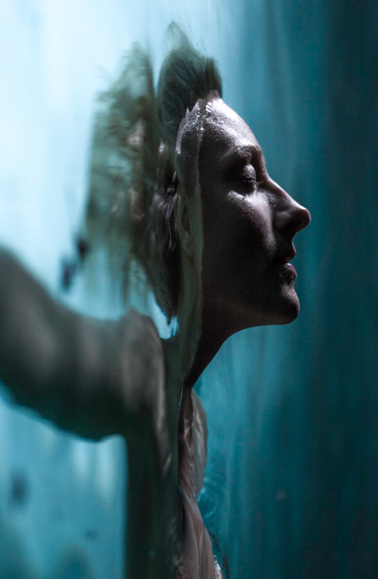 A vertical portrait of a women in the water.