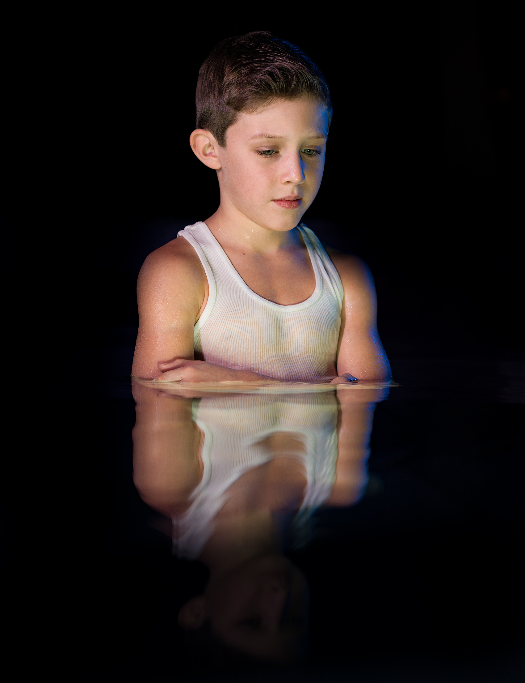 reflection of a half way submerged young man