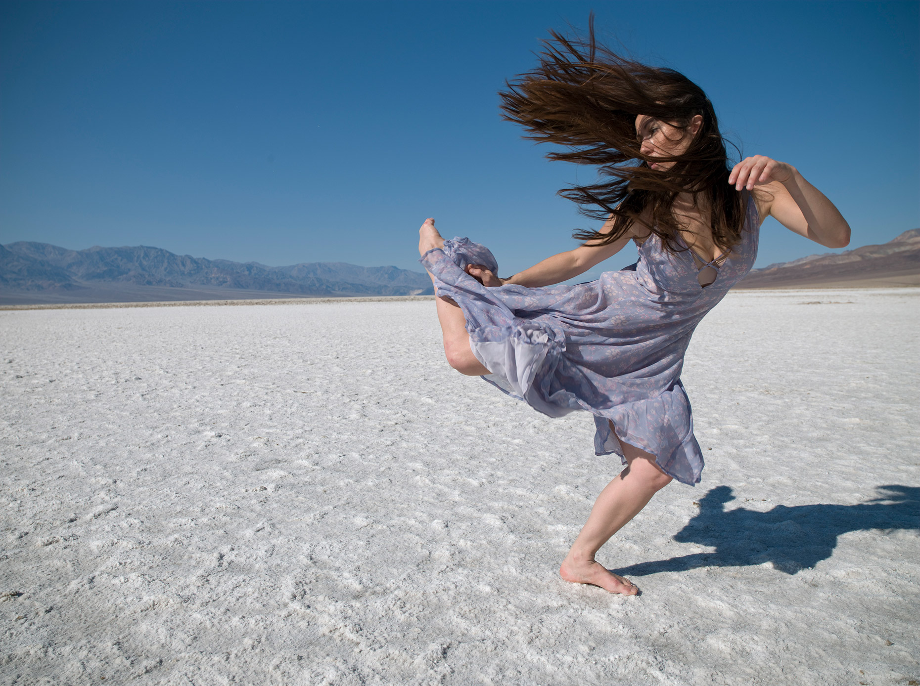 Dancer in a windy Death Valley dancing in the wind.