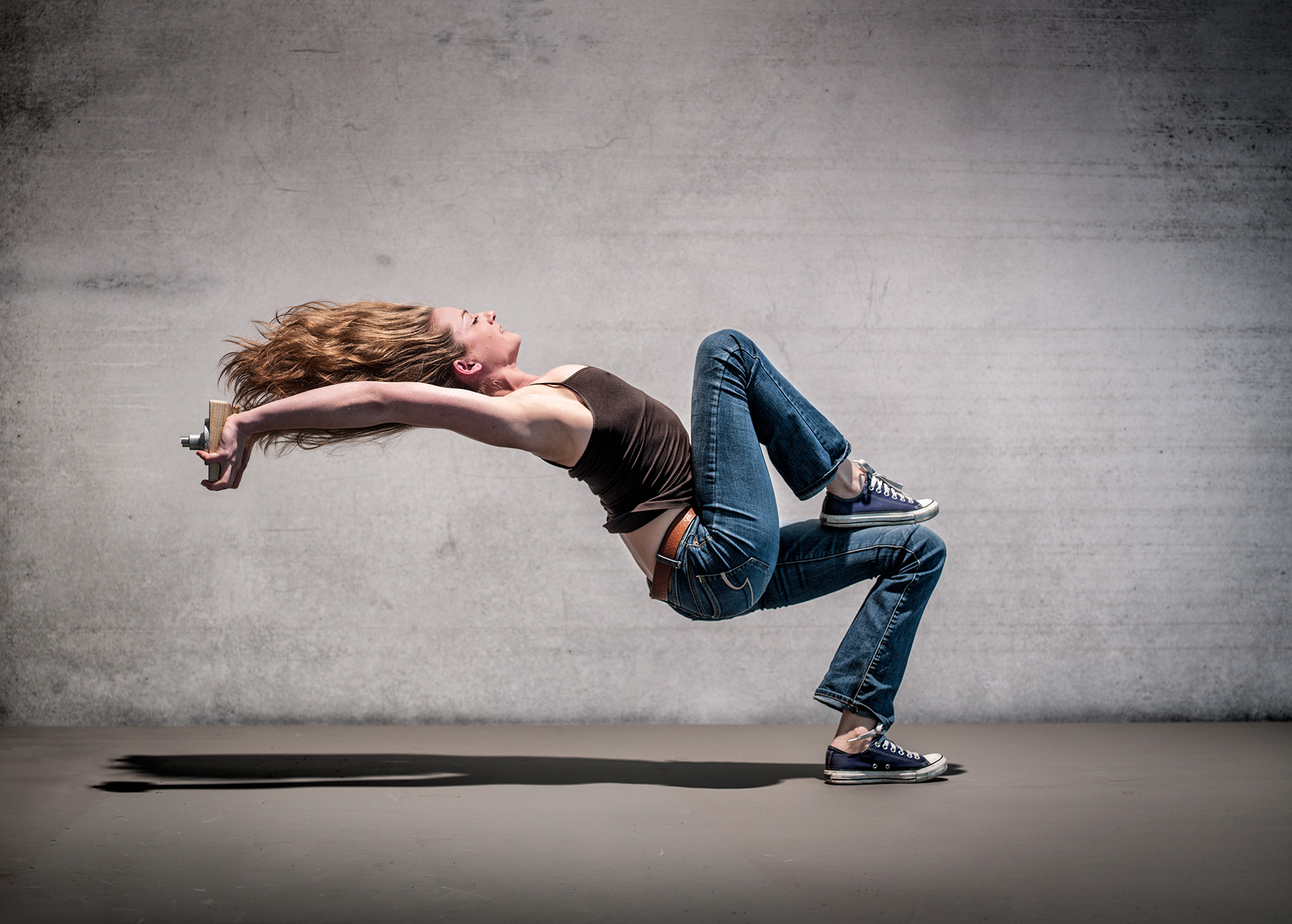 Woman leaning backwards with her flowing sidewise. Dynamic position advertising acrobatic move. Cirque du Soleil. Advertising editorial fine art portrait.