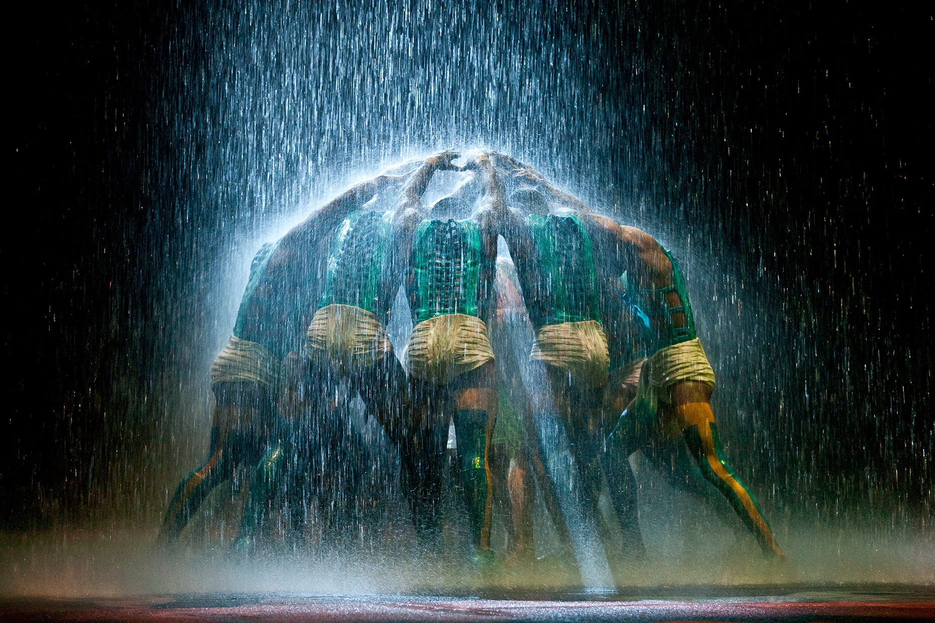 Acrobatic performers forming a roof. Cirque du Soleil, Dragone, The House of Dancing water