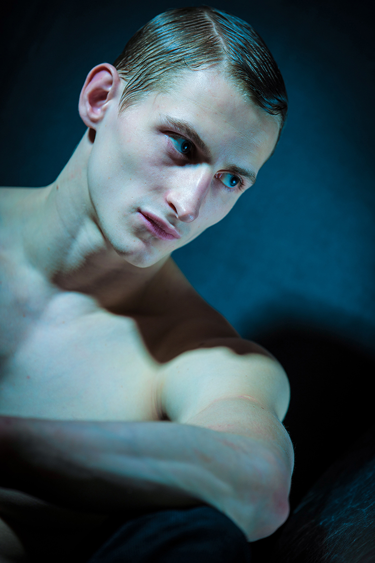 man in blue tint. Handsome man portrait. fine art. editorial