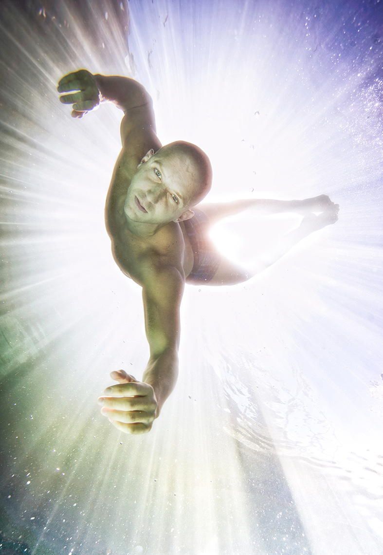 underwater fine art editorial  jump dance in the beam of sunlight