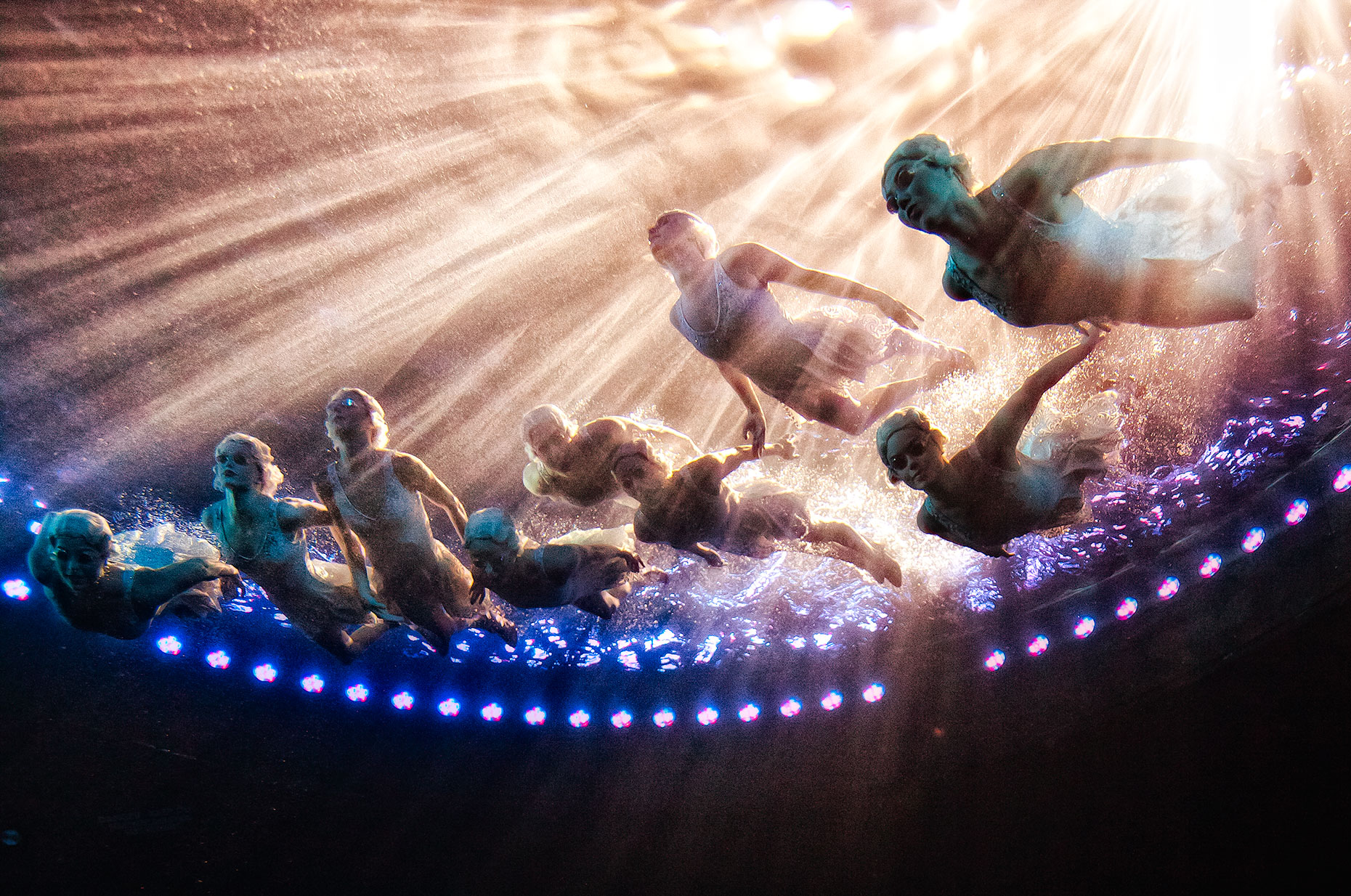 Underwater shot of synchronized swimmers Le RÊVE the Dream show At the Wynn Las Vegas Advertising