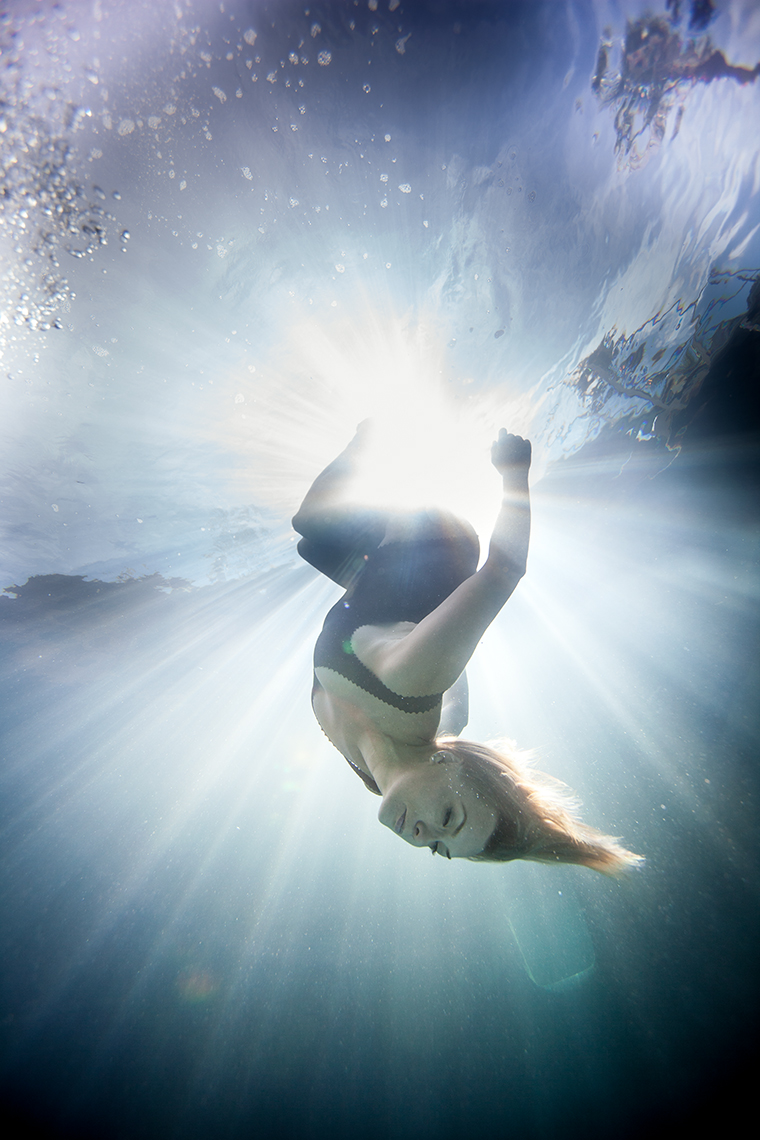 in the beam of light upside down under water beauty