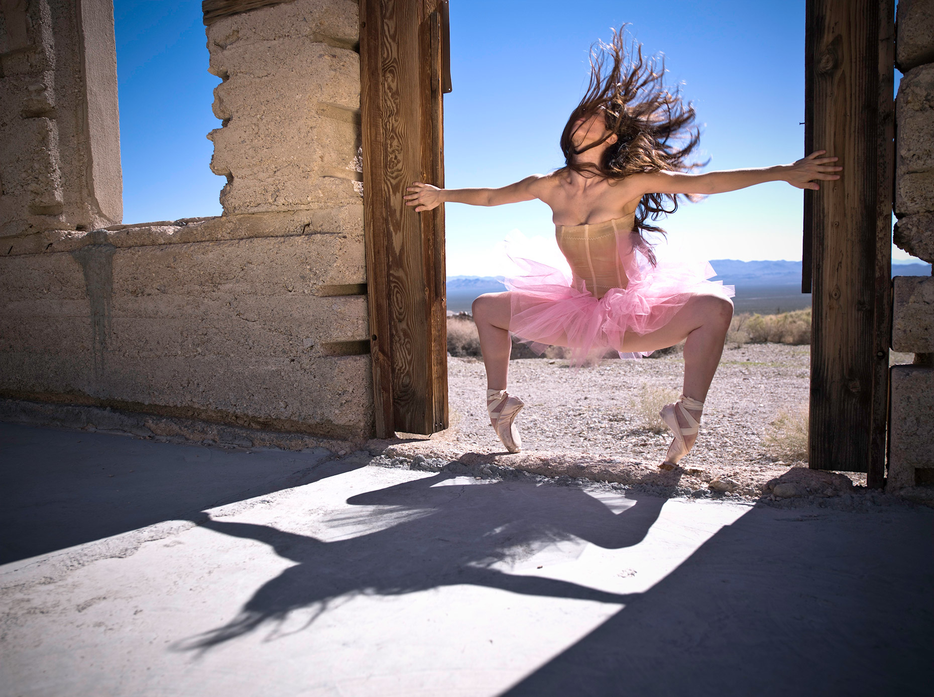 Dancer in pink in a doorway.